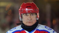 Russia's Vladimir Putin laces up skates for hockey game with ex-NHL stars