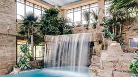 Race car driver's $20M Colorado estate features indoor grotto, car museum
