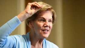 Warren reveals millionaire status from work as bankruptcy lawyer