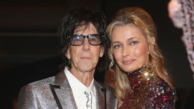 Rock star's supermodel widow wants piece of estate after being cut from will