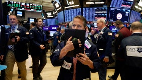 Stocks sink as Boeing 737 Max delayed, coronavirus reaches US