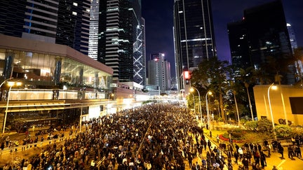 Hundreds of thousands march as Hong Kong protests near half-year mark