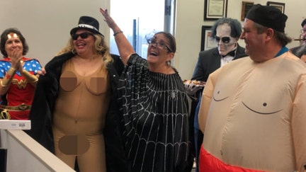 'Flasher' costume sees school director demoted, pay cut