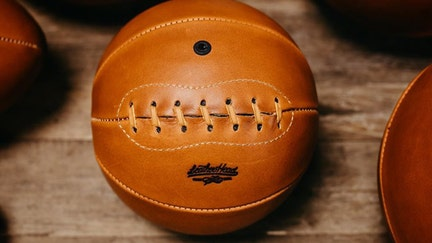 Ex-MLB employee starts company in his home making vintage leather sports balls