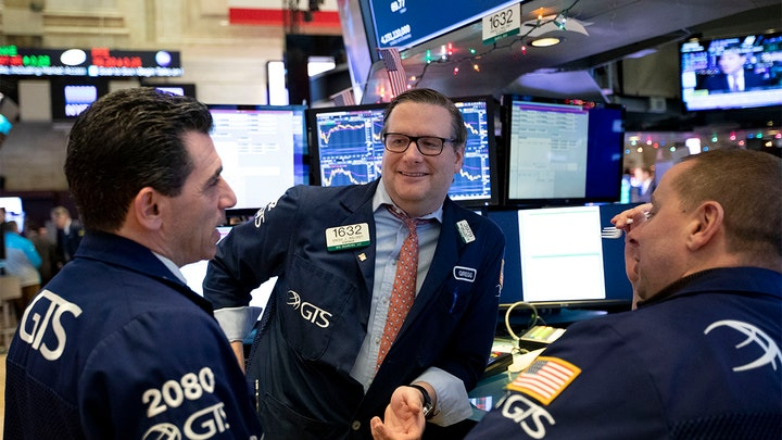 Stocks rally to records, Nasdaq blows past 9,000 for first time