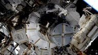 Spacewalking female astronauts tackle final battery improvements