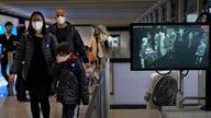 Wuhan bans cars, Hong Kong closes schools as coronavirus spreads