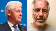 Photos show Bill Clinton smoking cigar, enjoying himself aboard Jeffrey Epstein's jet