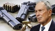 Democrat contender Bloomberg's gun control group helps city sue firearms-maker