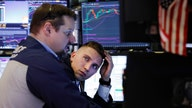 Stocks slump as coronavirus spreads, earnings roll on