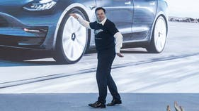 Elon Musk dances to celebrate first made-in-China Tesla vehicles