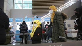 China virus outbreak rams global tourism, costing billions