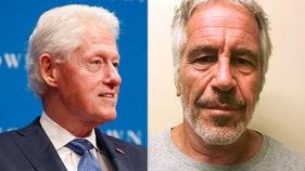 Bill Clinton seen smoking cigar, enjoying himself aboard Epstein's jet