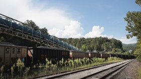 Miners, families gather on tracks to block train over missed paychecks