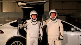 SpaceX astronauts ride in Tesla cars to space station launch pad
