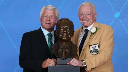 Jerry Jones congratulates Jimmy Johnson on Hall of Fame election