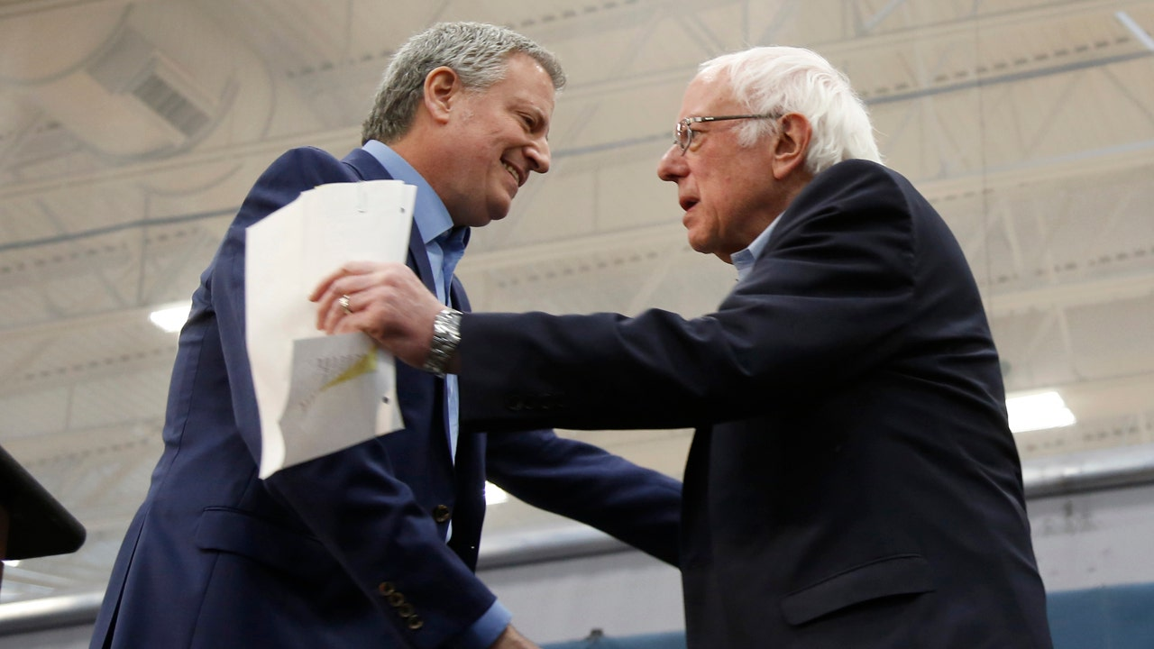 De Blasio defends using taxpayer money on security while stumping for Sanders