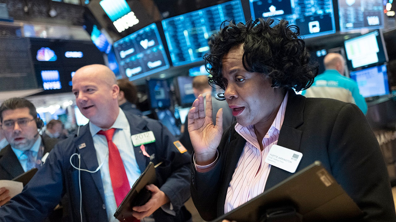 Stocks hit records as coronavirus slows, Sanders rallies Dems