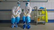 Coronavirus breaks into China prisons as global markets, businesses take hit