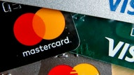 Visa, Mastercard could raise swipe fees on many merchants: sources