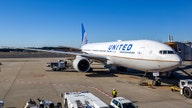 United to reduce flight capacity by 50%, cut corporate officers' pay