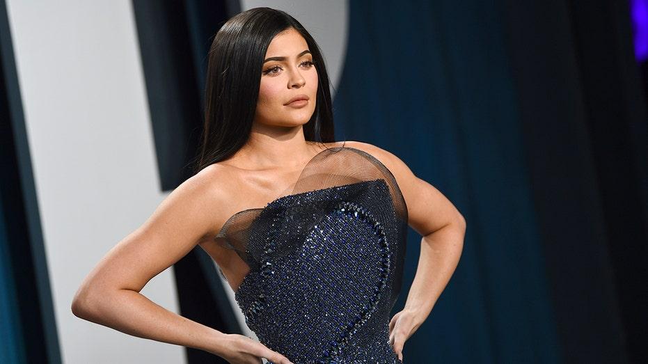 Kylie Jenner Tries To Take Off Stormi Webster's Hoop Earrings