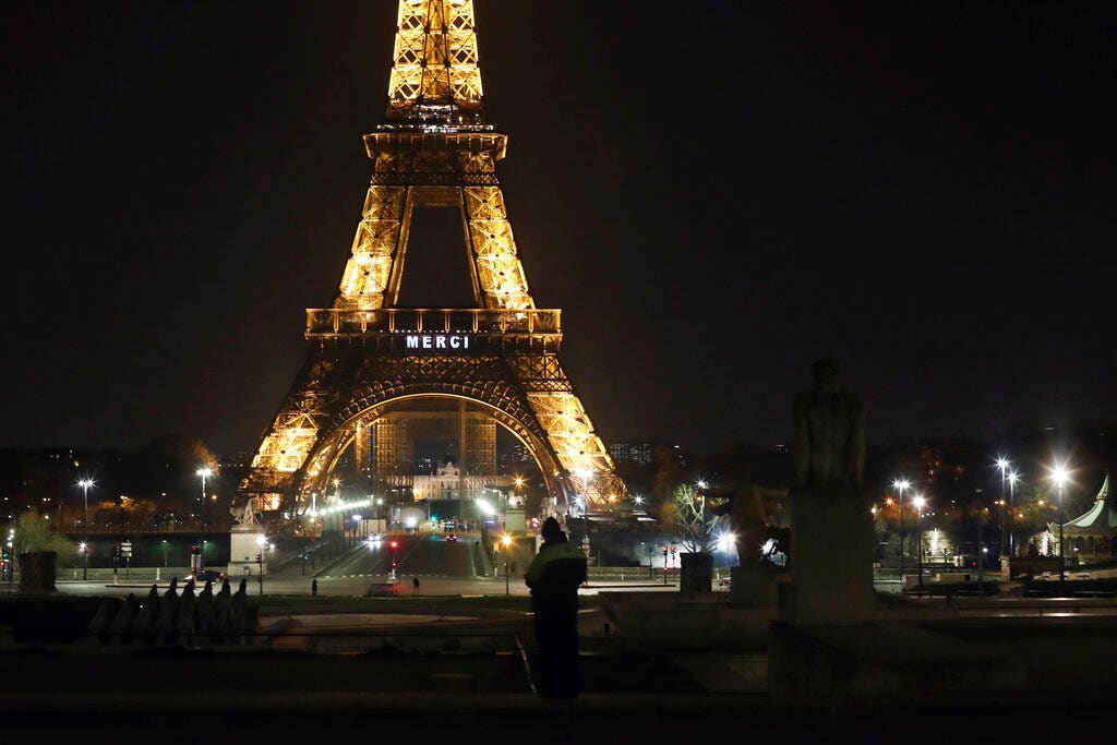 Eiffel Tower says 'Merci' to health workers fighting virus