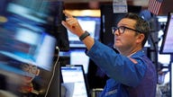 Dow futures tumble 1,000 points after Fed takes emergency action