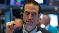 Stock futures trade lower despite stimulus measures