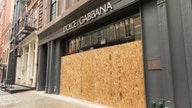 Businesses protect themselves from coronavirus-spurned civil unrest by boarding up storefronts
