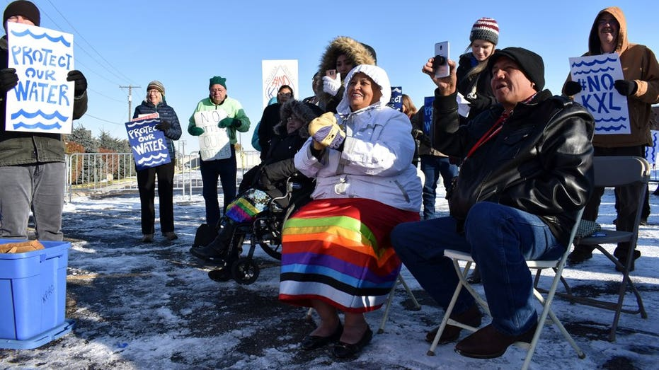 In this Oct. 29, 2019 photo, opponents of the Keystone XL oil pipeline from Canada demonstrate in sub-freezing temperatures in Billings, Mont. (AP Photo/Matthew Brown)