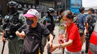 Hong Kong protests erupt amid China law debate, hundreds arrested