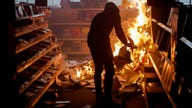 Stock futures trade lower as riots grip America