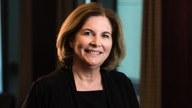Who is Kansas City Federal Reserve President Esther George?