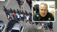 Fired Florida sheriff who hid in car during Parkland shooting reinstated