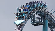 Reopened theme parks ban screaming on roller coasters. Riders are howling