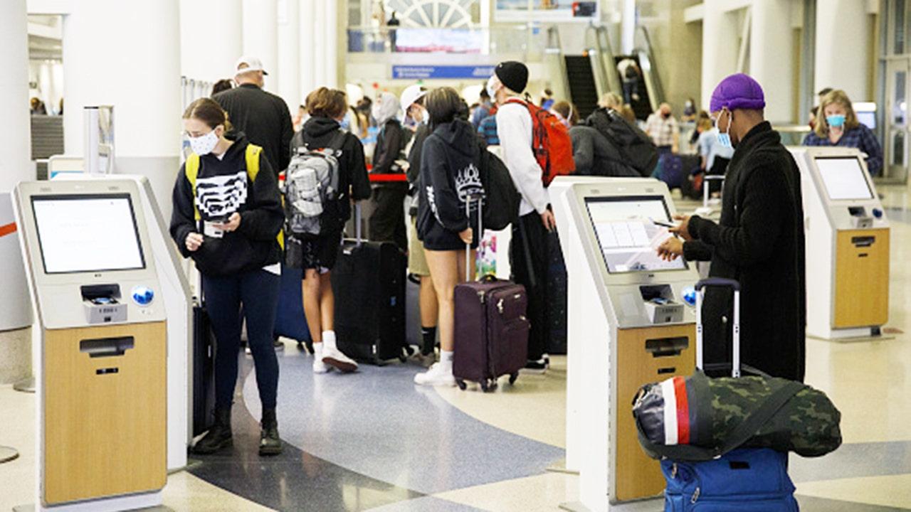 Even as coronavirus cases jump, fewer airlines blocking...