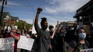 Protests turn subdued after new charges in George Floyd case