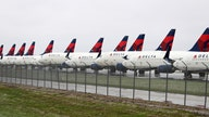 Delta Air Lines takes $7B loss as coronavirus grounds flights