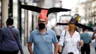 Coronavirus social distancing at Paris gallery uses 'deconfinement' hats