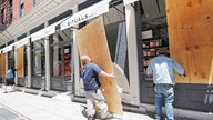American stores reluctant to uncover boarded-up windows amid civil unrest, coronavirus