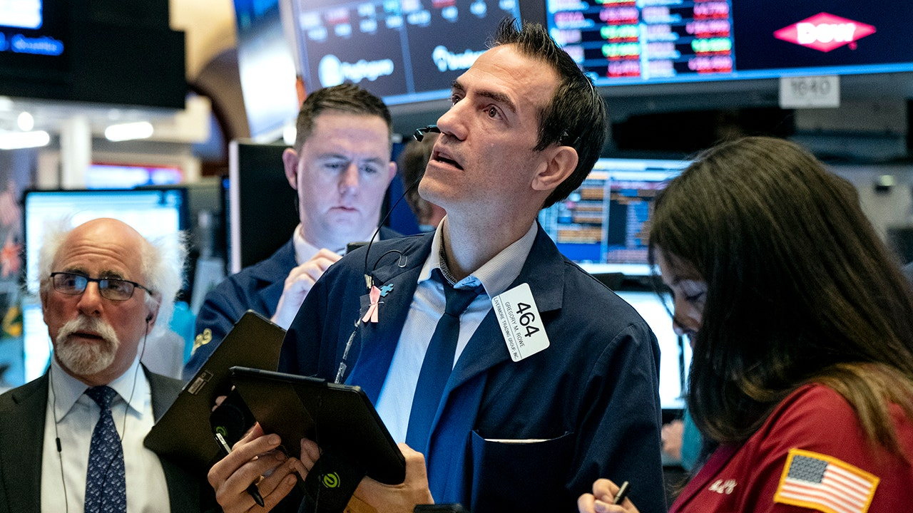 Stock futures trade higher adding to gains