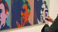 Justice Department seeks Warhol, Monet paintings tied to 1MDB scandal