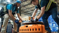 Amazon fulfillment center features robots working alongside employees