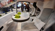 Automakers rethink the car with swivel seats, self-cleaning buttons and window art