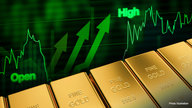 Gold prices zoom into record books, set sights on further gains