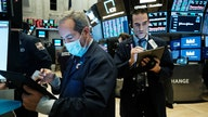 Stocks fight for gains as job market shows improvement
