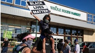 Portland Whole Foods workers walk out after employee says he lost job over anti-racism button