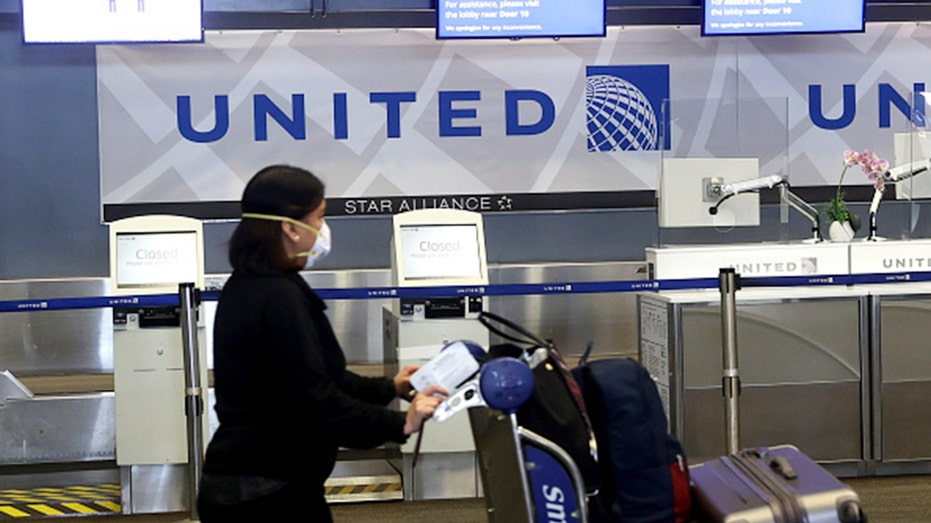 United Air expands face-mask requirement to airports, lounges