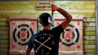Stressed-out Americans seek out axe throwing, shooting ranges